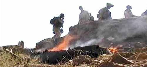 Burning Afghan bodies