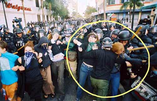 Undercover cop pushing protestors toward beating