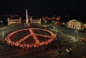 Human peace sign on the Magyar Heroes Square