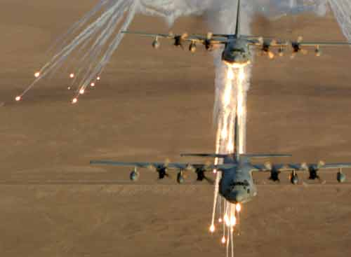 C-130s laying suppression fire before landing.