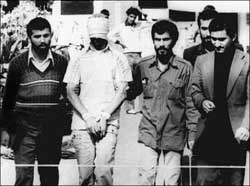Revolutionaries escorting CIA from US embassy