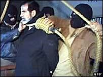 Saddam Hussein being hanged by lynch mob.