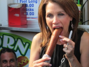 Michele Bachmann eats a foot-long corn-dog at the Iowa State Fair
