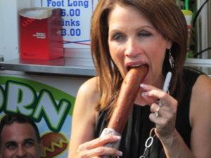 Michele Bachmann eats a foot-long corn-dog at the Iowa State Fair